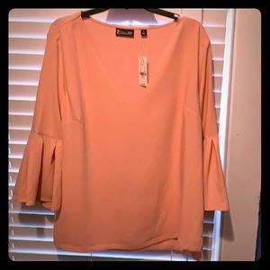 Blouse never worn.  Pretty light pink color